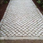 Cobblestone path with belgian block border gets you through the mud